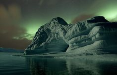 Northern lights over iceberg in North East Greenland. For licensing see…