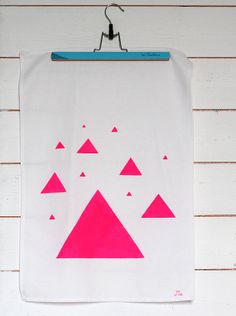 Triangles tea towel in neon pink by LesMiniboux on Etsy, €19.00