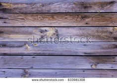 Close-up of the surface (wall, floor or overhead) made of wooden plank, panel or board in the brown, purple shade with white and gray reflect