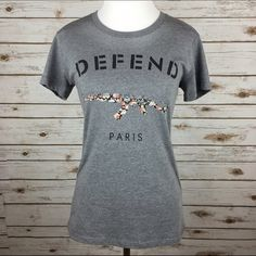 "[DEFEND Paris] Floral Logo Graphic Tee Shirt Top Fitted crew neck logo tee from DEFEND Paris. A great layering piece. I think it looks cool under an olive military jacket. Add some distressed boyfriend jeans and you're set! Made in the USA.  Color: Gray Fabric: Cotton & Polyester Size: Large (I think it runs small and could easily fit a Medium) Bust: 17"" Length: 25"" Condition: EUC. Like new. No flaws.  No Trades! No PayPal! DEFEND Paris Tops Tees - Short Sleeve"
