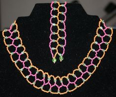 SOLD. Peach & Pink Weave Collar features Peridot Green Czech crystals and seed beads. Czech crystal and seed beads fit together for clasp. Pair with matching bracelet.