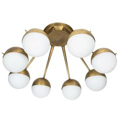 1960s Italian Eight-Arm Brass and Glass Chandelier in the Manner of Stilnovo
