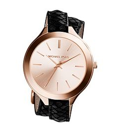 Double your wrist's chic factor with our elegant Slim Runway watch. In radiant rose gold-tone stainless steel and embossed leather, this timepiece offers up a fresh take on a true classic The buckled bracelet wraps twice, giving you a layered look that reads cool and modern, while the high-shine dial completes the understated design. Wear this piece solo, or mix it with delicate rose gold pieces for a stylishly stacked wrist.