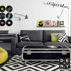 Ikea rug, records, our sofa, yellow