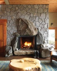large boulders as part of otherwise ordinary stone fireplace facing. Concrete Fireplace, Stove Fireplace, Fireplace Design, Fireplace Mantels, Cottage Fireplace, Fireplace Ideas, Rustic Outdoor Fireplaces, River Rock Fireplaces, Fireplace Facing