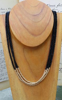 Black and gold charlotte cut seed bead by PumpkinMoonDesigns, $30.00