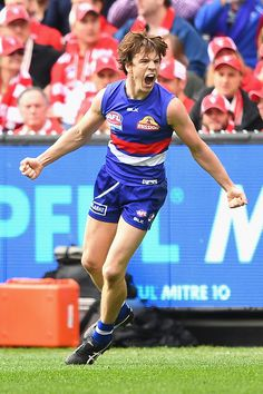 Liam Picken of the Bulldogs celebrates kicking a goal during the 2016 AFL Grand Final match between the Sydney Swans and the Western Bulldogs at. Melbourne, Sydney, Western Bulldogs, Great Team, Big Time, Sport Man, Swans, Exterior Colors, Demons