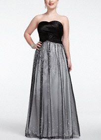 Long and luxurious, you are the center of attention in this striking prom dress.   Strapless satin bodice features stunning banded detail on bust.  Long sparkling glitter skirt adds drama to this already sensational number.  Fully lined. Back zip. Imported polyester. Spot clean only.  COMING SOON to stores and online.