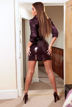The stunningly beautiful Natalia Forrest in tight shiny purple pvc skirt and sexy satin shirt.