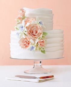 Romantic, ruffled wedding cake with sugar flowers
