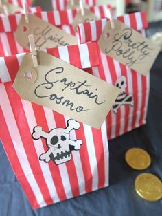 Pirate Party Ideas — Pirate Loot Party Favours — we made pirate 'loot' bags out of red and white striped gift bags secured with a tiny wooden peg. They fit the pirate theme so well and were roomy enough for lots of pirate related gifts. #pirateparty #piratepartyideas