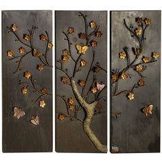 inspiration... wood panels, 'hammered' spray paint in metallics, then hand painting over it.... I really think I could do this!