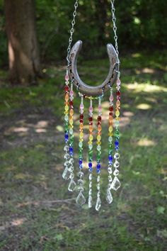 Excited to share this item from my etsy shop horseshoe sun catcher rainbow sun catcher garden art yard decor Horseshoe Projects, Horseshoe Crafts, Horseshoe Art, Horseshoe Ideas, Beaded Horseshoe, Carillons Diy, Décoration Harry Potter, Art Perle, Diy Wind Chimes