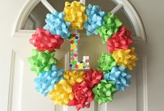 Birthday party wreath made with just bows!!! I can see this at Christmas with red and green bows!!!