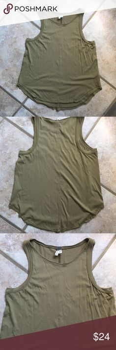 """We The Free High Neck Tank Top High neck line that hits at collar bone. Sleeveless T-Shirt/Tank with unfinished hem. Soft olive green color. Scoop hemline. Cotton/modal blend.   Chest: 18""""  Length: 22.5-24.5"""" Free People Tops Tank Tops"""