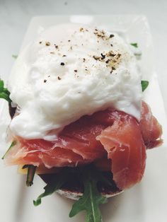 Norway style sandwich with salmon, pashot-style egg and ruccola