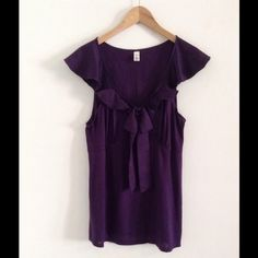 """Beautiful top Merona Super Cute and it's in good preowned condition.  →Length----25.5""""  →Armpit to armpit----19.5"""" while lying flat  →Material------100% modal  → bundle to save 10% → No swaps on this item  → No holds (first come, first serve)  → Comes from a smoke-free / pet-free home  → Will ship within 24 hours Merona Tops Blouses"""