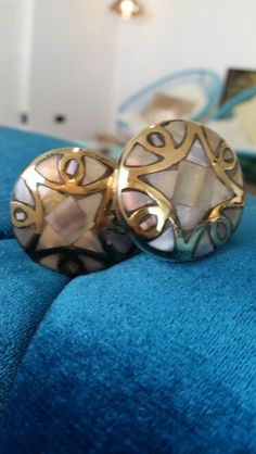 My gorgeous mother of pearl and brass knobs for my liquor cabinet