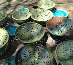 colanders in the sun (pottery by Dawn Tagawa):