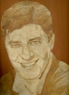 In rice straw art there is no BLACK or WHITE.  All look alike.  Jerry Lewis in leaf art. Handmade with rice leaves.