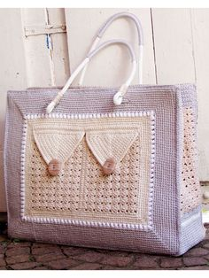 Shopping Bag With 3 Pockets Crochet Pattern download from Annie's Craft Store. Order here: https://www.anniescatalog.com/detail.html?prod_id=135224&cat_id=468