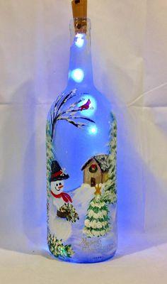 Snowman Wine Bottle - Christmas illuminated bottle of snowman painted wine bottle Wine Bottle Art, Painted Wine Bottles, Lighted Wine Bottles, Bottle Lights, Wine Bottle Crafts, Jar Crafts, Bottle Bottle, Vodka Bottle, Christmas Wine Bottles