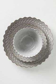 These grey cloud colored dishes from Anthropologie will replace the ridiculously designed ones we got from Crate and Barrel that flip if you try to cut anywhere but the exact center of the plate.  These are so pretty!