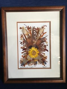 Framed dried native austrailian flowers This one-of-a-kind artpiece,, is made with real natural flowers and greenery including:  Blue gum & eucalyptus leaves, wattle, kangaroo paw, cats paws, bottle brush an opther plants native to Australia  .   This artwork can be free standing or hung on a wall. solid wooden frame,  To ensure its longevity please never expose it to direct light. Collection South Kirkby, Pontefract Can be posted be ask for price