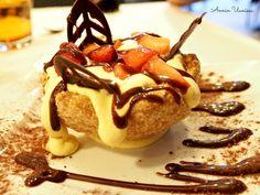 Mascarpone cheese, strawberries, chocolate on a italian biscuit.