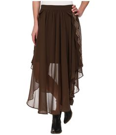 You'll float down the sidewalk like a dream in this beautiful Ariat Ingle Skirt. ; Fluttering semi-sheer overlay boasts a handkerchief hemline. ; Elastic waistband with smocked back. ; Tribal-inspired embroidery accents the sides. ; Partially lined. ; 100% polyester; Lining: 100% polyester. ; Machine wash cold, tumble dry low. ; Imported. Measurements: ; Skirt Length: 34 in ; Waist Measurement: 25 in ; Product measurements were taken using size SM. Please note that measurements may vary by…
