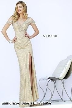 Sherri Hill - 32019 from Miss Priss is Old Hollywood glam!  The nude, champagne color is covered in crystal, rhinestone beadwork and draping cap sleeves adds sophistication.  Stun everyone at your next formal event, great Gatsby themed party, prom, or pageant!