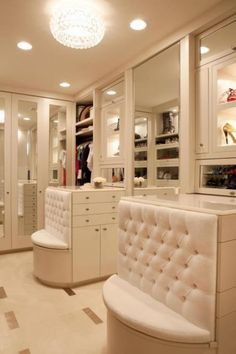 Master Closet with tufted bench seating. Super cute!