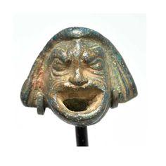 * A Roman Actor's Mask Applique, Roman Period,1st - 2nd century A.D.