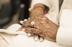 Markham Convention Centre Wedding | Roma and Jigar | Wedding ring on this South Asian bride's hand. We love the henna #torontoweddingphotographer #weddingphotography #southasianwedding ~ http://www.focusproduction.ca/south-asian-wedding-photography-videography/roma-jigar/