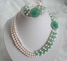 Image from http://img.alibaba.com/wsphoto/v0/397895522/Jewelry-real-white-pearl-green-jade-necklace-bracelet-Free-Shipping.jpg.