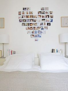 Polaroid heart college over bed serving as head board.