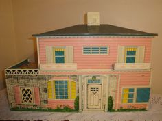 Pink tin doll house.