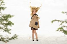 www.frostedproductions.com l #utah #photographer #editorial #photography #little #girl #in #the #snow #winter #woods #pine #trees #antlers #amazing #hair #cute #clothes