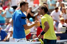 MONTREAL, QC - AUGUST 08: Jerzy Janowicz of Poland congratulates Rafael Nadal of Spain after their match during the Rogers Cup at Uniprix Stadium on August 8, 2013 in Montreal, Quebec, Canada.