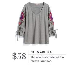 Love the embroidery on this shirt. Not sure about the ties in the sleeves but looks like a cute sweater.