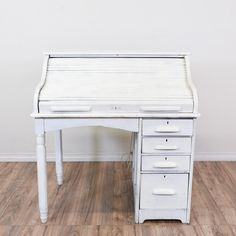 This shabby chic desk is featured in a solid wood with a distressed white finish. This vintage secretary desk has four spacious drawers, dovetailed joinery, and a roll-away top featuring storage compartments underneath. Perfect for storing school supplies, studying and doing homework! #shabbychic #desks #secretarydesk #sandiegovintage #vintagefurniture