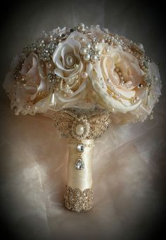 This is for a Custom made Vintage Inspired Jeweled Wedding Bouquet This bouquet is custom designed and made with Soft ivory Colors with a touch of Pale Blush Pink added with all Gold Brooches and Gem