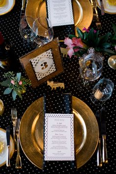 gold and black reception - photo by Christie Graham Photography http://ruffledblog.com/glam-wedding-with-a-french-bulldog-theme #placesetting  #weddingideas #blackandgold