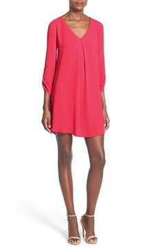 Free shipping and returns on Lush 'Karly' Shift Dress at Nordstrom.com. An inverted pleat beneath the V-neckline structures a drapey shift framed with cute roll-tab sleeves.
