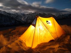 My MSR Twin Sisters winter tent glows from within, in the middle of the night high on the Bridge of Heaven above Ouray, Colorado. Storm clouds blow away from the San Juans in the background. Snow Camping, Camping Glamping, Winter Camping, Outdoor Camping, Camping Hammock, Hammocks, Camping Ideas, Camping Photography, Mountain Photography