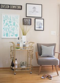 Bar Cart Styling with Unison. A vintage brass gold bar cart brings a touch of glam to this space. A tall white vase brings in added height and works as a sculptural piece.