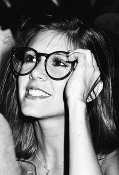 Carrie Fisher trying on Harrison Ford's glasses.