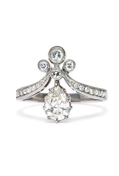 """Brides.com: . There's something so special about vintage-inspired engagement rings. Even though they're not actually decades old, they give your most important piece jewlery an elegant, timeless and seriously one-of-a-kind feel.  As for what defines a ring as a """"vintage"""" aesthetic, it's truly all in the details. Etched metals, floral motifs, smaller, triple-set stones, and even gem stones like sapphires, rubies, and emeralds give a ring an old-world feel. Back in the day, rose-cut and ..."""