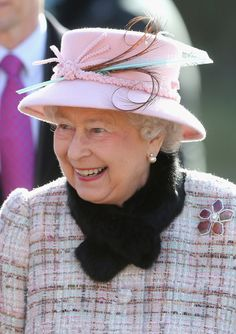 Queen Elizabeth II smiles as she attends church at West Newton on February 2, 2014 in King's Lynn, England