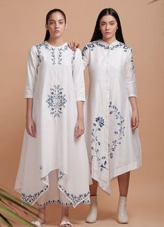 Beautiful Silk Asymetric Kurtis with grey embroidery. Great placement of embroidery create rich look. Beautiful Silk Asymetric Kurtis with grey embroidery. Great placement of embroidery create rich look. Tunic Designs, Kurta Designs Women, Kurti Neck Designs, Kurti Embroidery Design, Embroidery Fashion, Embroidery Dress, Embroidery Stitches, Women's Dresses, Casual Dresses